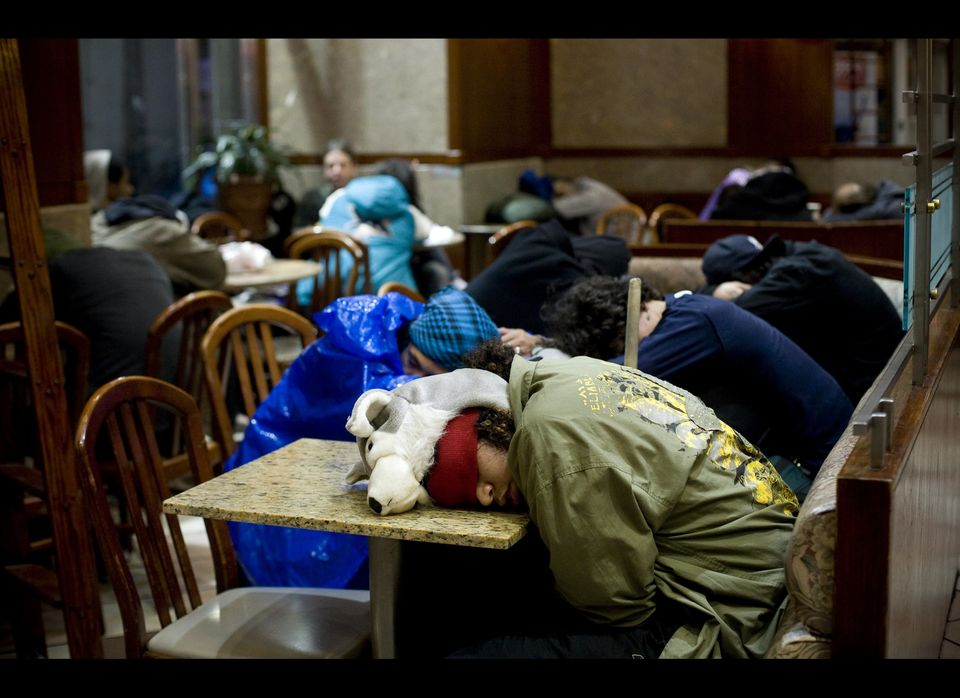 Occupy Wall Street protesters sleep in a McDonalds near Zuccotti Park on November 16, 2011 in New York City. Police had remov