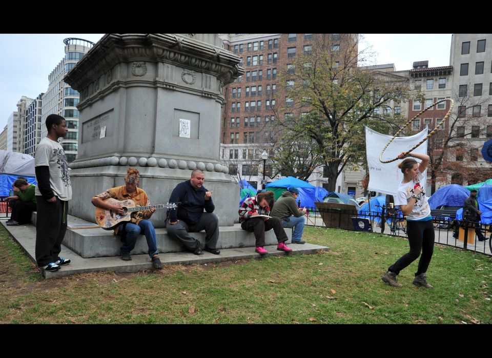 Occupy DC protesters in McPherson Square entertain themselves in Washington, DC, on November 21, 2011. Occupy DC popped up sp
