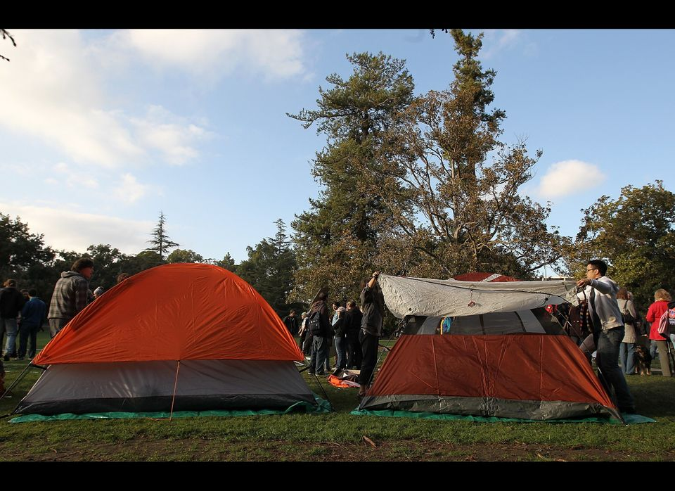 DAVIS, CA - NOVEMBER 21:  Occupy protesters set up a tent as they re-occupy the quad area during a demonstration at the UC Da