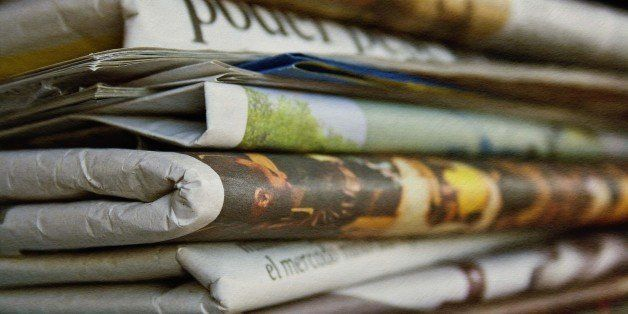 Colorful newspapers. A texture has been applied to the image