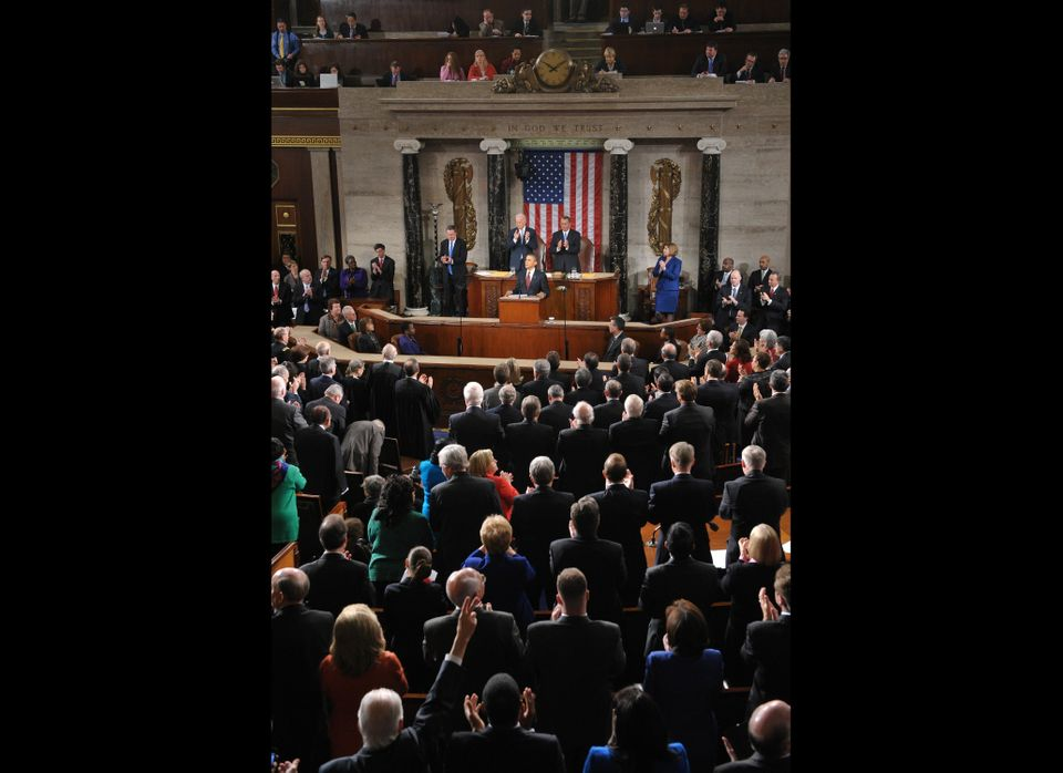US President Barack Obama receives applause as he delivers his State of the Union address before a joint session of Congress