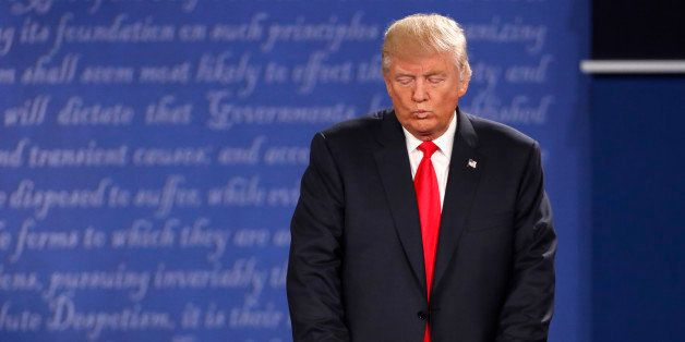 Republican U.S. presidential nominee Donald Trump listens as Democratic U.S. presidential nominee Hillary Clinton (not pictur