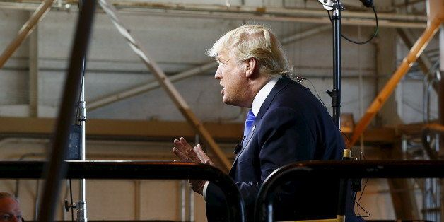 Republican presidential candidate Donald Trump gives an interview to Bill O'Reilly of Fox News before speaking at a campaign