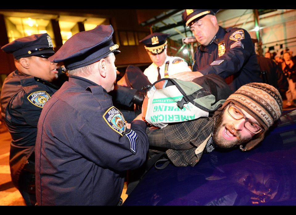 Policemen arrest Occupy Wall Street participants after they staged a march down Broadway as part of May Day celebrations in N
