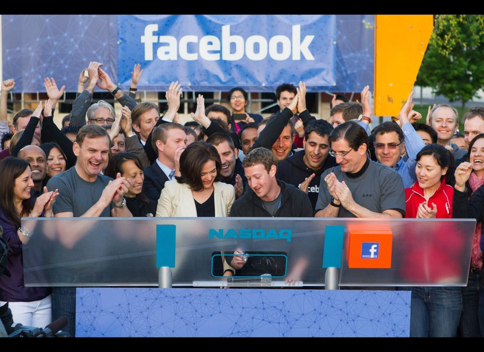 In this image provided by Facebook, Facebook founder, Chairman and CEO Mark Zuckerberg, center, rings the opening bell of the
