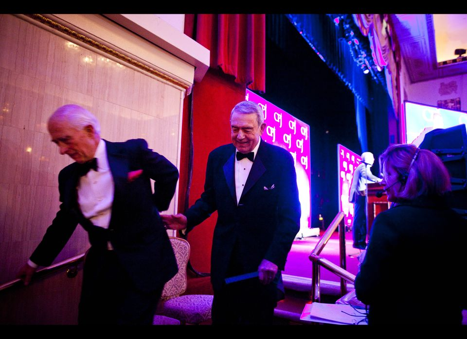 NEW YORK - NOVEMBER 22:  American journalist Dan Rather (C) walks off stage with First Amendment lawyer James Goodale (L) aft