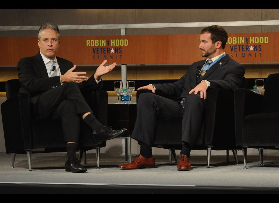 NEW YORK, NY - MAY 07:  Jon Stewart and Salvatore Giunta, Medal of honor Recipient speak at the Robin Hood Veterans Summit at