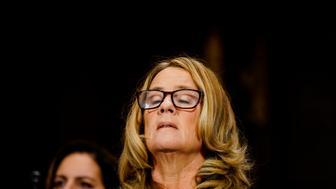 WASHINGTON, DC - SEPTEMBER 27: Christine Blasey Ford takes a breath at a Senate Judiciary Committee hearing on Thursday, September 27, 2018 on Capitol Hill. (Melina Mara/Pool/The Washington Post via Getty Images)