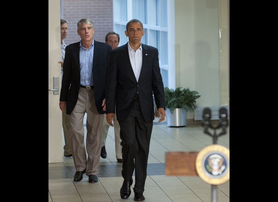 US President Barack Obama arrives alongside Colorado Senator Mark Udall (L) to speak at the University of Colorado Hospital i