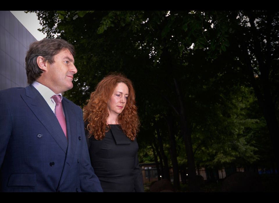 Rebekah Brooks, (R) former Chief Executive of News International, and her husband Charlie Brooks arrive at Southwark Crown Co