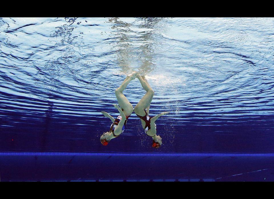 Natalia Ischenko and Svetlana Romanshina of Russia compete during women's duet synchronized swimming preliminary round at the