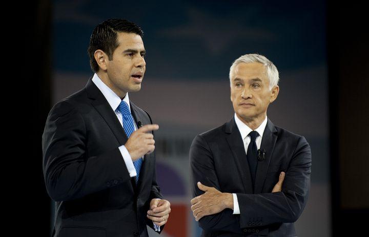 Noticiero Univision co-Anchor and 'Al Punto' host Jorge Ramos (R) and Univision President Cesar Conde (L) introduce US Presid
