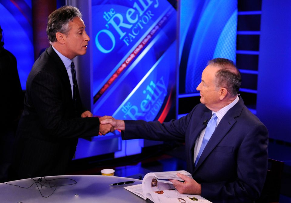 FILE - In this Sept. 22, 2010 file photo, Comedy Central's Jon Stewart, left, and Bill O'Reilly tape an interview in New York