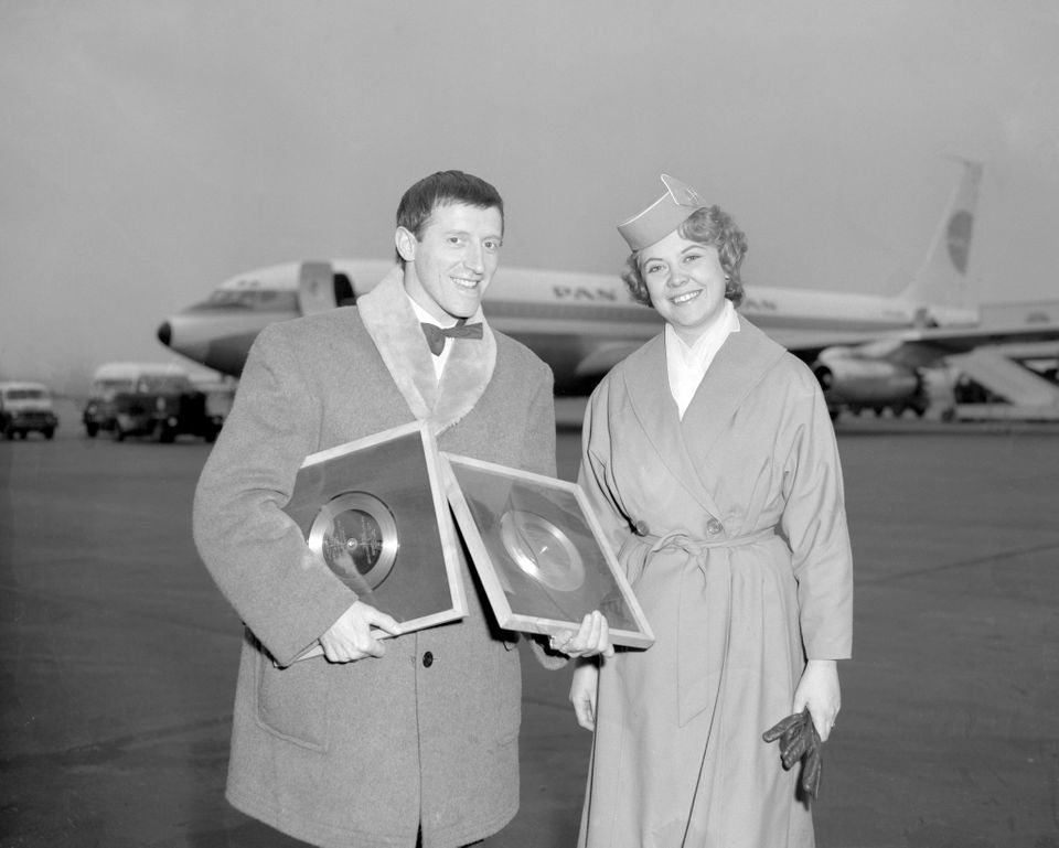 Jimmy Savile in 1961 around the time he was working for Radio Luxembourg. He is at London Airport with Pan American stewardes