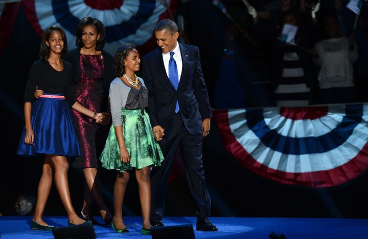 US President Barack Obama and family arrive on stage after winning the 2012 US presidential election November 7, 2012 in Chic
