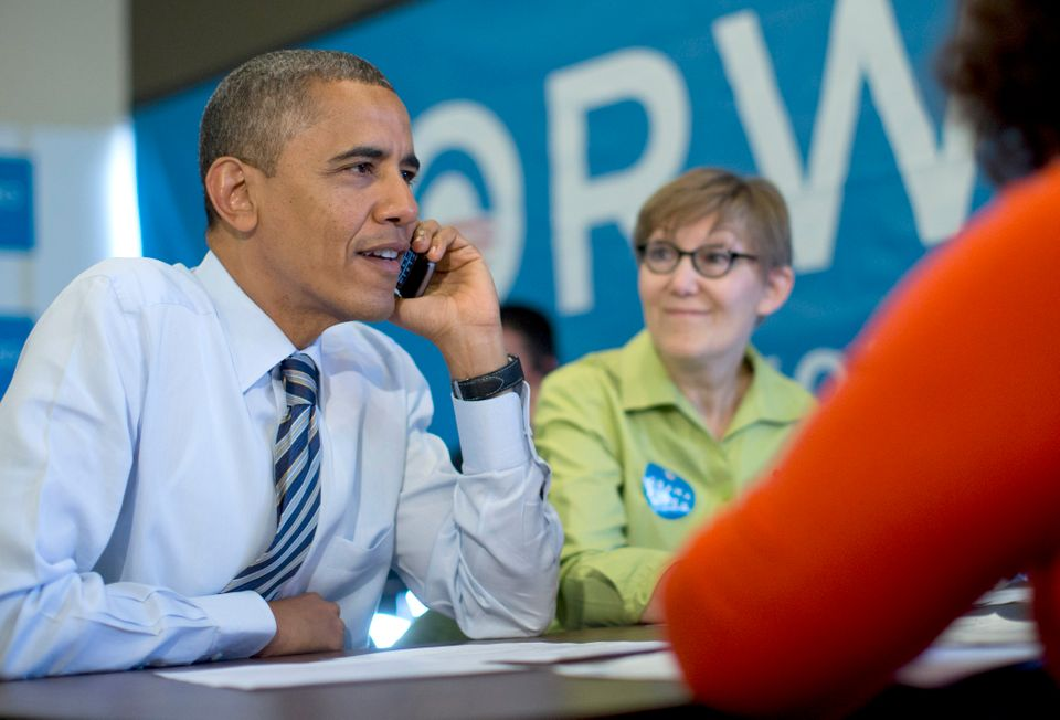 President Barack Obama calls to thank volunteers in Wisconsin, at campaign office call center the morning of the 2012 electio