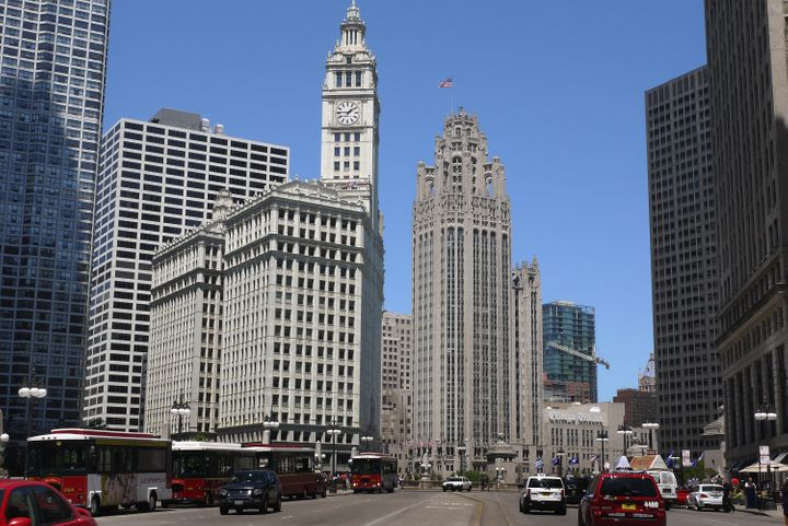 CHICAGO, IL - JUNE 07: Vehicles travel along Wacker Drive near the Tribune Tower (right center), headquarters of the Tribune