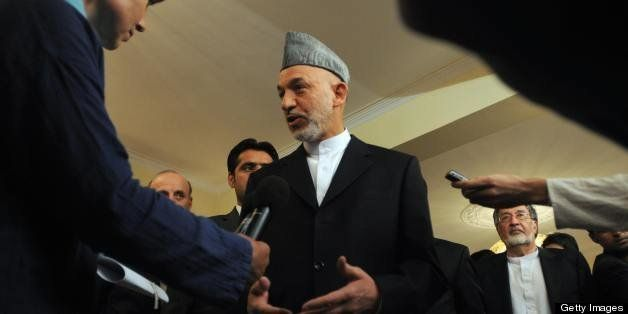 Afghan President Hamid Karzai speaks to journalists after a press conference at the Presidential Palace in Kabul on August 20