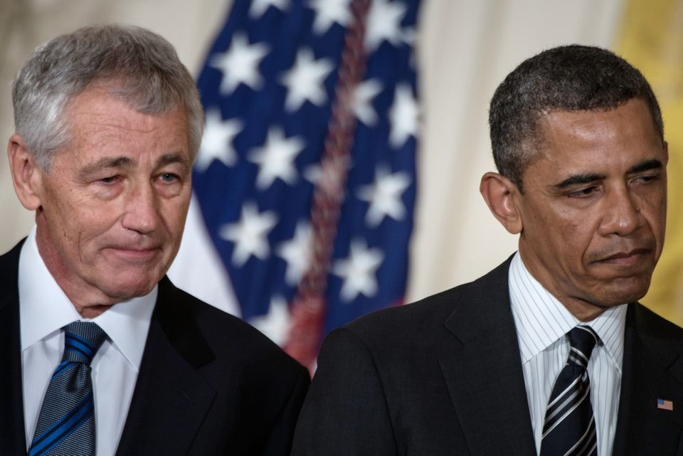 Chuck Hagel and US President Barack Obama listen during an event in the East Room of the White House on January 7, 2013 in Wa