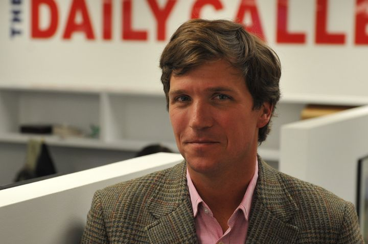 WASHINGTON, DC - JANUARY 7: Tucker Carlson, a conservative pundit, at the office of the new website, the Daily Caller, on Jan