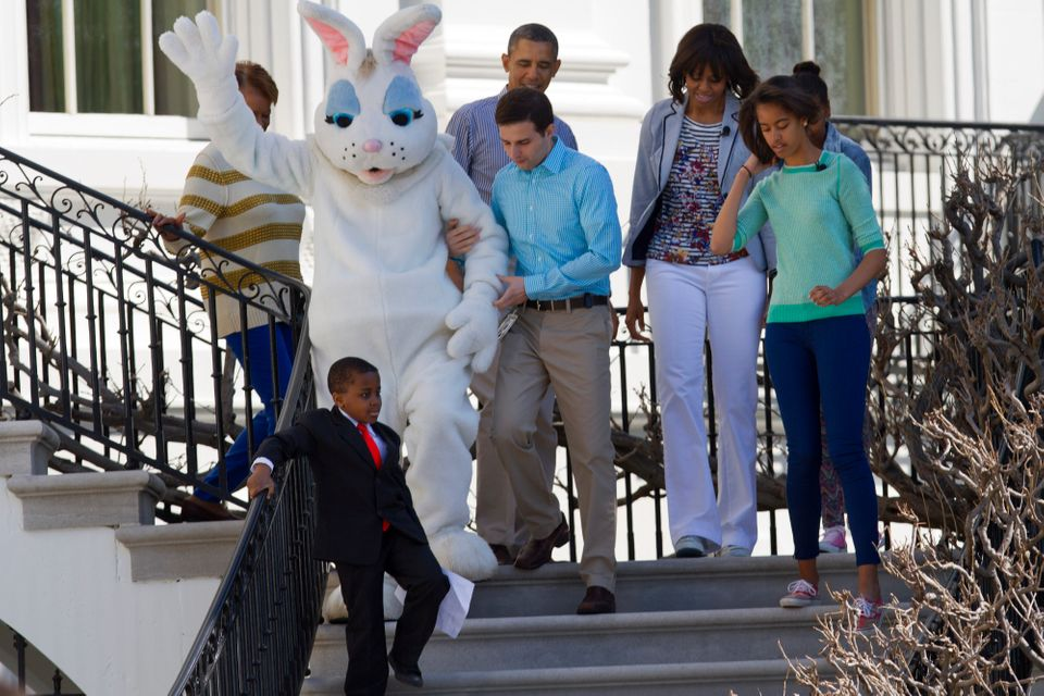 Robby Novak, known as Kid President, followed by President Barack Obama and his family, first lady Michelle Obama, daughters
