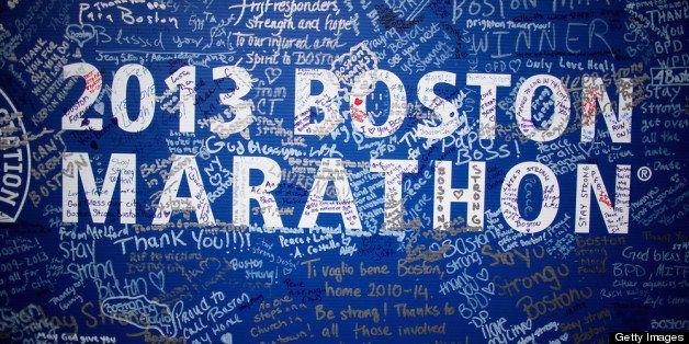 BOSTON, MA - APRIL 23:  Signatures adorn a Boston Marathon poster near the site of the Boston Marathon bombings on April 23,