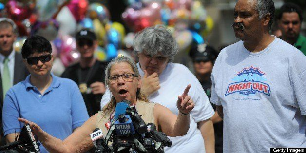 Gina DeJesus's parents Nancy and Felix (R)  talk to the press after their daughter arrived at her family home on May 8, 2013