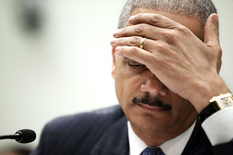WASHINGTON, DC - MAY 15:  U.S. Attorney General Eric Holder pauses as he testifies during a hearing before the House Judiciar