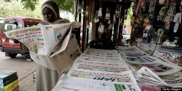 TO GO WITH STORY BY GUILLAUME LAVALEE A Sudanese woman reads a local newspaper in Khartoum on June 9, 2010. State censorship