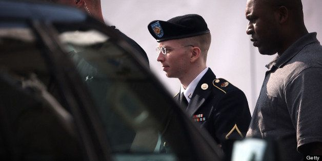 FORT MEADE, MD - JUNE 03:  U.S. Army Private First Class Bradley Manning (C) is escorted as he leaves a military court for th