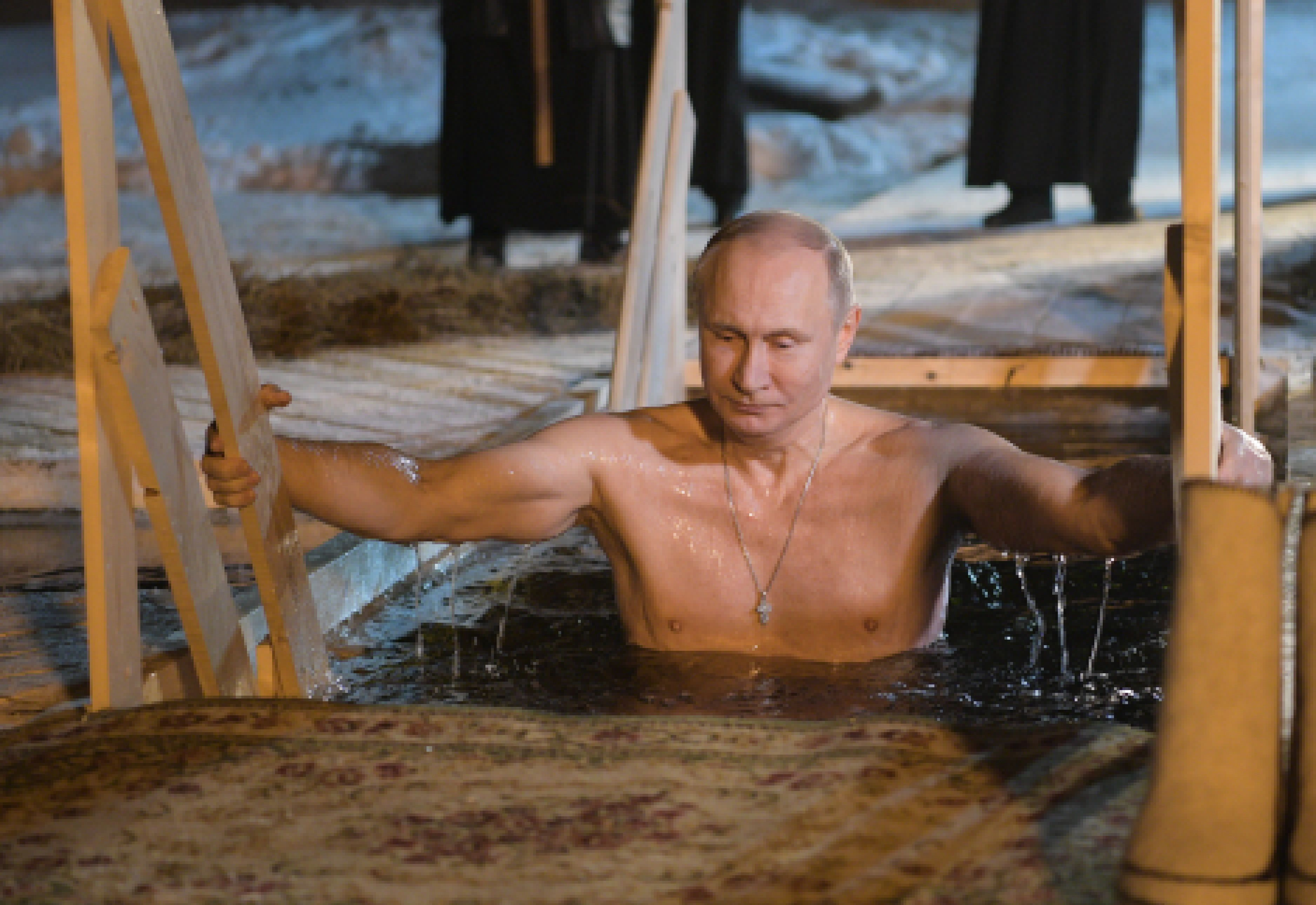 TVER REGION, RUSSIA - JANUARY 19, 2018: Russia's President Vladimir Putin dips in the icy waters of Lake Seliger during the celebration of Epiphany. In Eastern Christianity, the feast of Epiphany commemorates the Baptism of Jesus. The Russian Orthodox Church celebrates the holiday according to the Julian calendar. Alexei Druzhinin/Russian Presidential Press and Information Office/TASS (Photo by Alexei Druzhinin\TASS via Getty Images)
