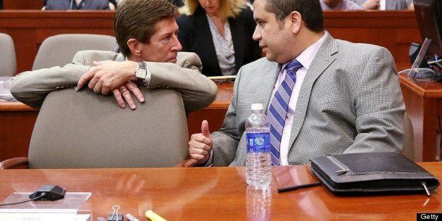 SANFORD, FL - JUNE 27:  Defense attorney Mark O'Mara (L) talks with George Zimmerman during Zimmerman's murder trial in Semin