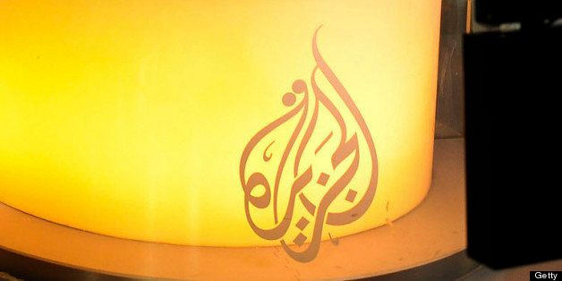 Al Jazeera network anchor Shihab Rattansi prepares to start the afternoon news program at the Al Jazeera English language cha