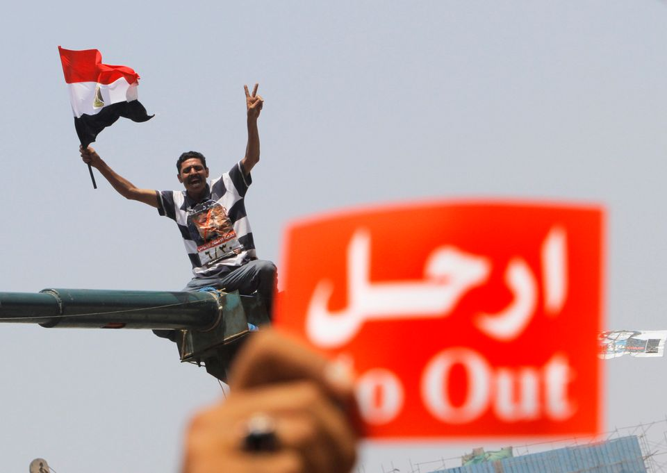 An opponent of Egypt's Islamist President Mohammed Morsi shouts slogans during a protest in Tahrir Square in Cairo, Egypt, We