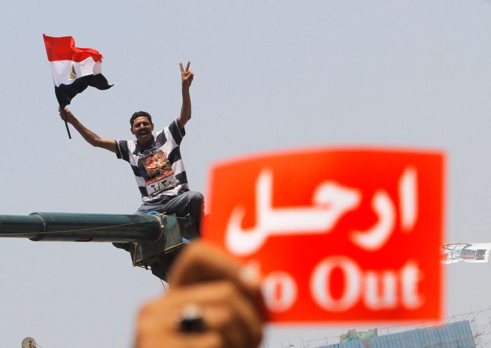 An opponent of Egypt's Islamist President Mohammed Morsi shouts slogans during a protest in Tahrir Square in Cairo, Egypt, We