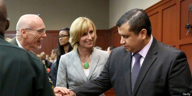 George Zimmerman is congratulated by his defense team after being found not guilty, on the 25th day of Zimmerman's trial at t
