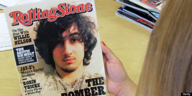 An early copy of Rolling Stone magazine's August 2013 issue is read at an office in Los Angeles on July 17, 2013. Rolling Sto