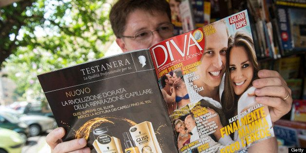 ROME, ITALY - JULY 24:  A man reads magazine 'Diva' at a newstand, where front pages of Italian newspapaers and magazines fea