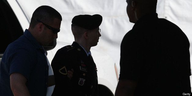 FORT MEADE, MD - JULY 30:  U.S. Army Private First Class Bradley Manning (c) is escorted by military police as arrives to hea
