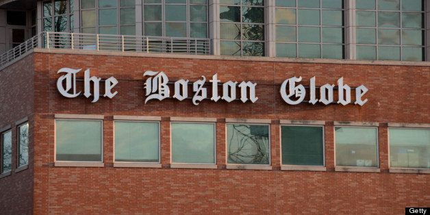BOSTON, MA - FEBRUARY 20: The Boston Globe signage hangs on the side of its building on February 20, 2013 in Boston, Massachu