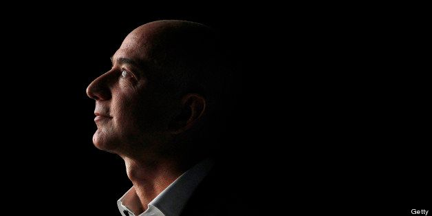 FILE PHOTO: 'BEST PHOTOS OF 2012' (***BESTOF2012***): Jeff Bezos, chief executive officer of Amazon.com Inc., watches a video