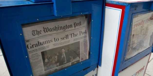 The front page of the Washington Post newspaper as seen in a newstand, August 6, 2013 in Washington, DC, the day after it was