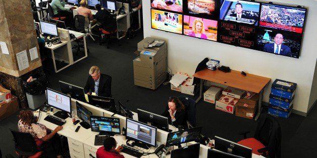 Journalists work in the main newsroom area of the new Al Jazeera America television broadcast studio on West 34th Street Augu