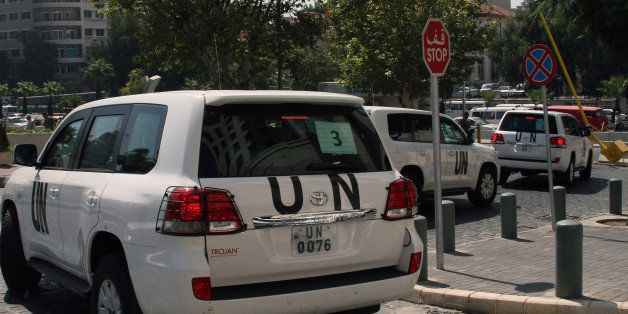 A convoy of United Nations (UN) vehicles leave a hotel in Damascus on August 26, 2013 carrying UN inspectors travelling to th