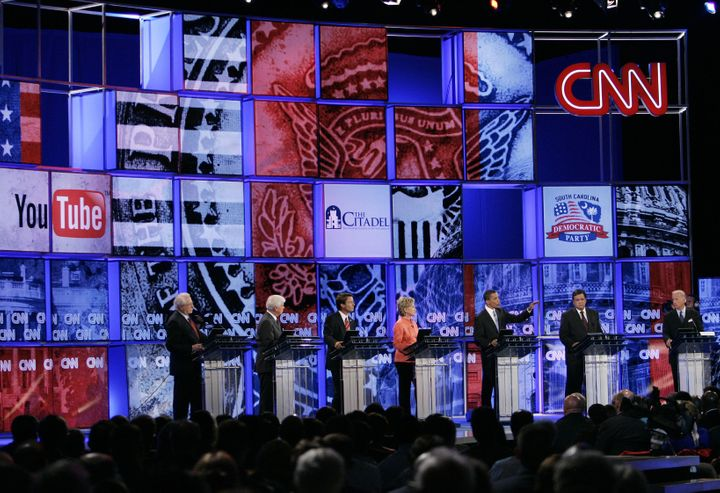 Candidates stand at their respective podiums during the CNN/YouTube Democratic Presidential Candidates Debate 23 July 2007 at