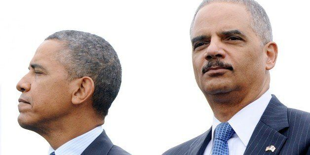 WASHINGTON, DC - MAY 15:  (AFP OUT) U.S. President Barack Obama (L) and Attorney General Eric Holder attend the 32nd annual N
