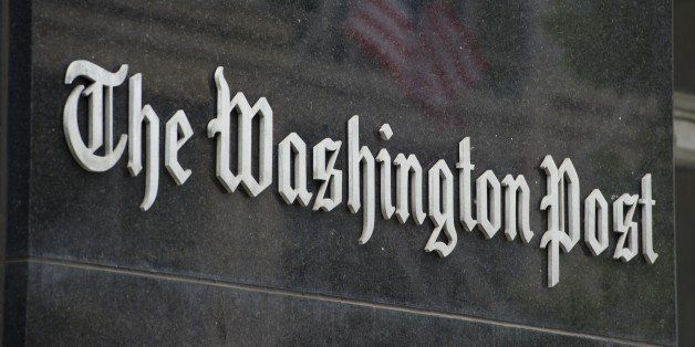 A sign hangs on the outside of the Washington Post Building August 6, 2013 in Washington, DC, the day after it was announced