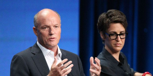 BEVERLY HILLS, CA - AUGUST 02:  President of MSNBC Phil Griffin (L) and Rachel Maddow host of 'The Rachel Maddow Show' speak