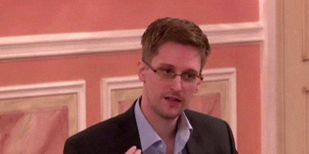 A frame grab made from AFPTV footage, reportedly taken on October 9, 2013, shows US intelligence leaker Edward Snowden speaki