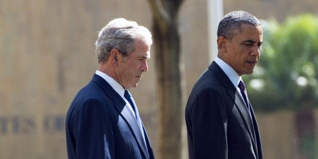 US President Barack Obama (R) and former US President George W. Bush arrive on July 2, 2013 for a wreath-laying ceremony for